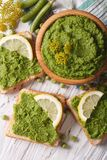 Green sandwiches with mashed peas close up. vertical top view Royalty Free Stock Photography