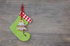 Green santa boots on a shabby wooden background for a christmas Stock Photos