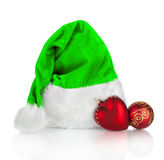 Green Santa Claus hat and red Christmas toy Stock Image