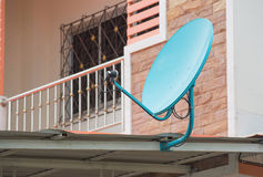 Green satellite dish on the roof Stock Photos