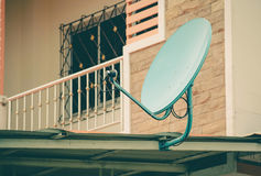Green satellite dish on the roof ,vintage Royalty Free Stock Photography