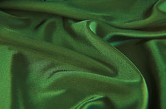 Green satin. A background of green satin stock photo