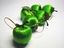 Green satin apple 11. Green satin Christmas apples on the grey background royalty free stock images
