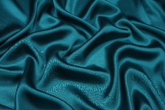 Green satin background Stock Images
