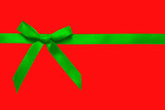 Green satin bow on red Stock Images