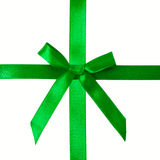 Green satin bow on a satin ribbon Royalty Free Stock Photography