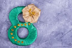 Green satin number eight. Green number eight, beige flower. Congratulation for someone important Stock Images