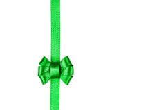 Green satin ribbon tied in a bow isolated on white Stock Photography