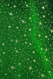 Green satin textile with golden glittering stars Royalty Free Stock Image
