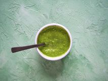 The green sauce in a bowl. Close up. Top view. stock photo