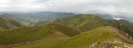 Green savanna mountain in Tibet - Qinghai province Royalty Free Stock Images