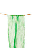 Green scarf hanging on a rope clothesline Stock Photos