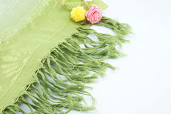 Green scarf for neck. Large green scarf for the neck when cold folding placed on a white background Stock Photo
