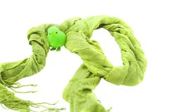Green scarf with a toy Royalty Free Stock Image