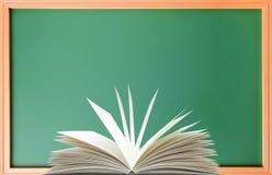 Green school blackboard and book Royalty Free Stock Photos
