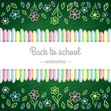 Green school board and colored chalks Royalty Free Stock Photography