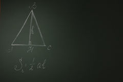 Green school board with geometric formula Stock Images