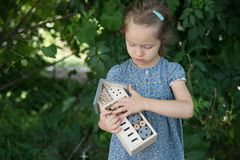 Girl holding insect hotel stock photo