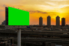 Green screen billboard beside express way at sunset Stock Image