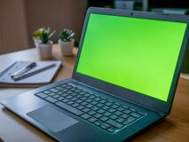 Green Screen Chroma Laptop Background on Home Desktop Working Remotely