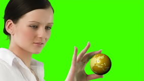 Green Screen Footage of a woman holding a Globe Stock Photography