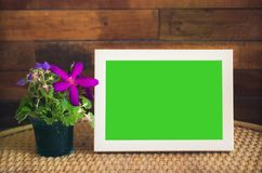 Green screen  frame. On table Stock Photo