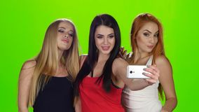 Green screen. Girls pose for the camera of the smartphone stock video footage