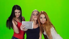 Green screen. Girls pose for the camera of the tablet stock footage