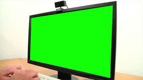 Green screen monitor and keyboard. Close-up of man's hands typing on a keyboard and a green screen stock video