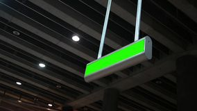 Green Screen overhead sign in underground modern subway station ALT. 
