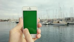 Green Screen Smart Phone Against With Yachts stock video footage
