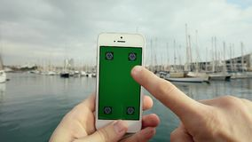 Green Screen Smart Phone in Passing Luxury Yachts stock footage