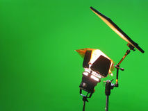 Green Screen Special Effects Studio. Light and photographic reflector against a vivid green backdrop as used in film and television compositing applications Stock Photos