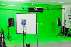 Green Screen Studio. Green Screen video production studio with lights set ready for filming Stock Photo