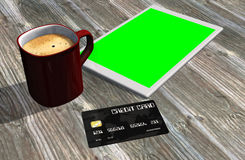 Green screen tablet PC credit card and cup of coffee Stock Photos