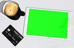 Green screen tablet PC credit card and cup of coffee Stock Photo