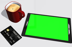 Green screen tablet PC credit card and cup of coffee Royalty Free Stock Photos