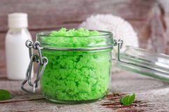 Green scrub in a glass jar Royalty Free Stock Images