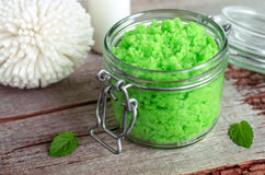 Green scrub in a glass jar Royalty Free Stock Image