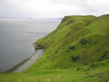 The green and the sea. Mountains and ocean in scotland Royalty Free Stock Photos
