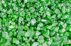Green sea bath salt texture close up. Marine salt crystals background. Royalty Free Stock Images