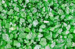 Green sea bath salt texture close up. Marine salt crystals background. Green sea bath salt texture. Marine salt crystals background Royalty Free Stock Images