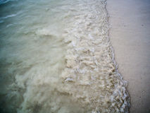 Green sea By the beach walkway The sea rushed to shore. Royalty Free Stock Images