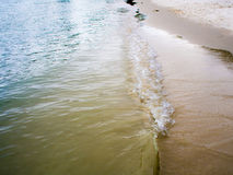 Green sea By the beach walkway The sea rushed to shore. Royalty Free Stock Photos