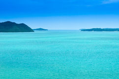 Green sea with blue sky Royalty Free Stock Photo
