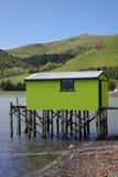 Green sea hut,. Otago Peninsula, dunedin, south island, new zealand Royalty Free Stock Photo