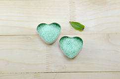 Green sea salt  in a heart shaped box Royalty Free Stock Photos