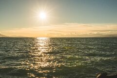 Green Sea Under Blue Sky during Day Time Royalty Free Stock Photography