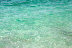 Green sea water in Is Arutas, Sardinia. Royalty Free Stock Image