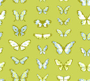 Green seamless background with butterflies Stock Photos